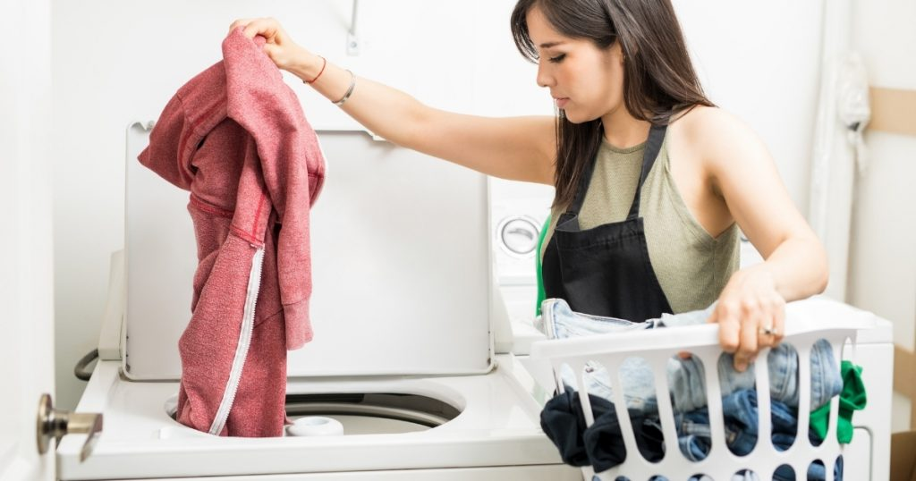 an image of a woman doing her laundry with the best washing machine