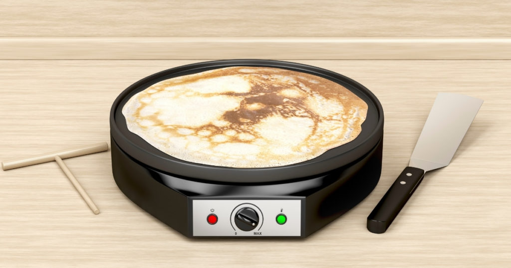 an image of the best electric frying pan making a pancake